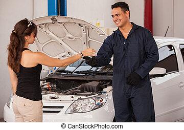 Getting car keys from a customer - Friendly mechanic...