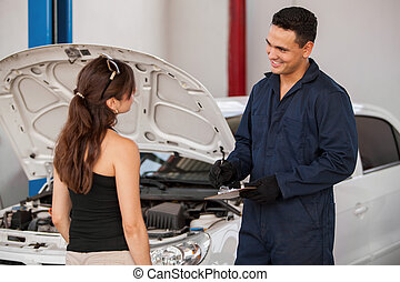 Receiving car from a customer - Handsome young mechanic...