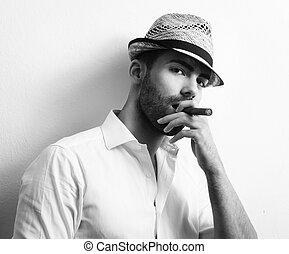 Man with cuban cigar - Young man smoking a cigar