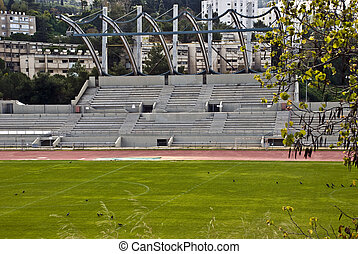 Tribune - Fragment of a soccer field with a tribune behind...