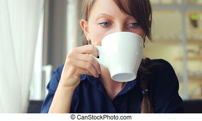 girl drinks coffee
