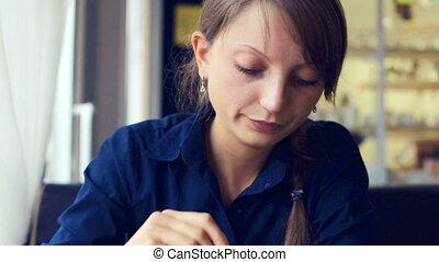 Girl eating dessert in cafe