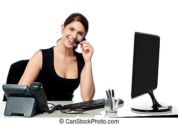 Female executive assisting client over a call - Young pretty...