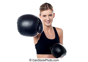 Fitness woman wearing boxing gloves - Pretty teen showing...