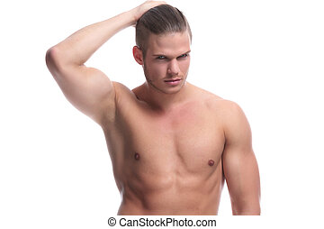 topless fashion man holds his hair