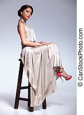beauty woman posing on a chair - young beauty woman posing...