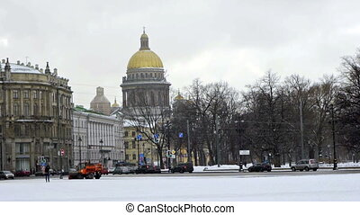 Tourists walking on Dvortsovaya square not far from Saint Isaac Cathedral, St. Petersburg, Russia