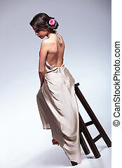back view of beauty woman on chair - back view photo of a...