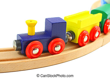 Wooden train toy on rails isolated on white