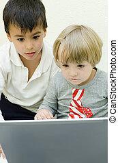 Children using laptop - Two children staring at laptop