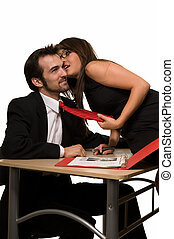 Office secrets - Brunette woman sitting on a desk in front...
