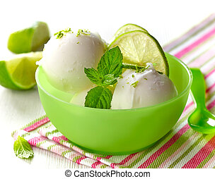 lemon sorbet decorated with lime slices and mint