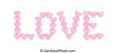 The word 'love' written with small candy hearts