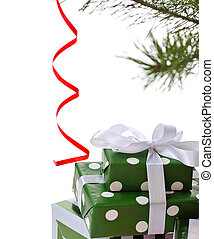 green gift boxes under Christmas tree - heap green gift...