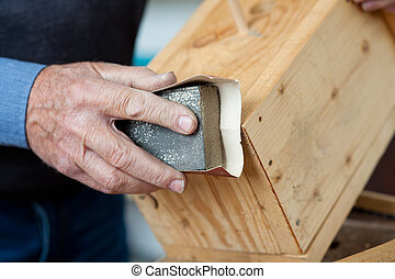 Using Sandpaper For Polishing Birdhouse At Workta - Using...