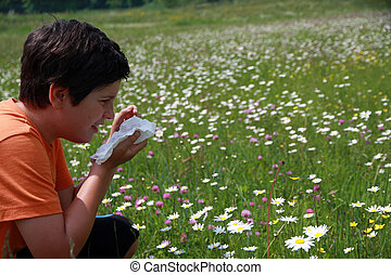 allergic child to pollen and flowers with a handkerchief...