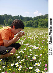 child with an allergy to pollen while sneeze in the middle...