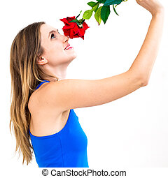 woman with a flower and thinking about love - young woman...