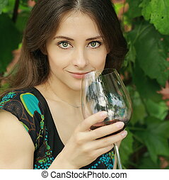 Beauty smiling woman drinking wine outdoor summer background...