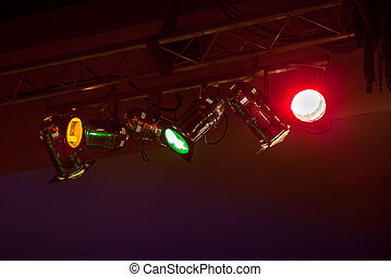 Disco light - Red, yellow, green floodlights at the disco