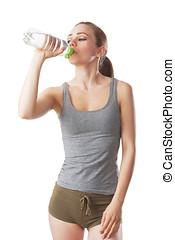 Sporty woman in fitness dress is drinking water from a water bottle isolated on white