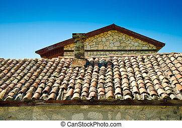 tile roof against the blue sky
