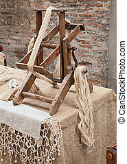 spinning hemp fiber - old winder machine with hank of hemp...
