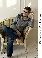 fashion man sits in the chair