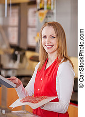 Saleswoman Preparing Meat Bill At Grocery Counter - Portrait...