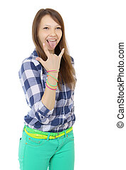 Teenage girl shows tongue and makes hand horns Mint-colored...