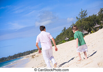 Family vacation. Happy father and son on the beach. Focus on...