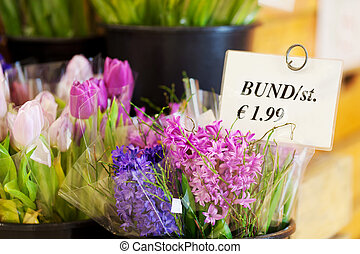Various Flowers With Price Tag In Shop - Closeup of various...
