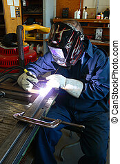Welder at work using TIG