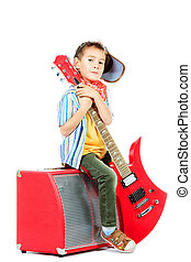rock stile - Cool little boy posing with electric guitar...