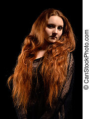 A red beauty - A ginger young woman has long red hair and...