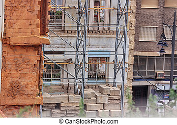 Old facades on reconstruction with scaffolding