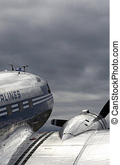 Airplane - Old airplane dc-3 with blue toning against the...