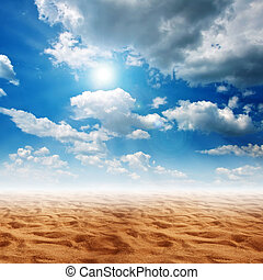 Sand desert - Desert land with brown sand, blue sky with...