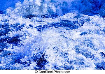 Splashing water in rapid river