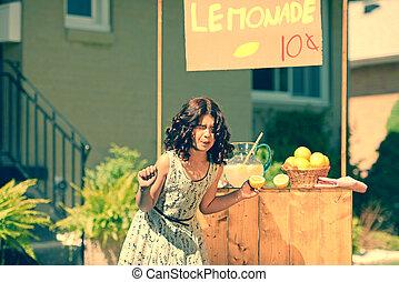 retro girl making funny face holding a lemon