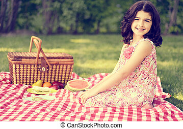vintage little girl having a picnic outdoors