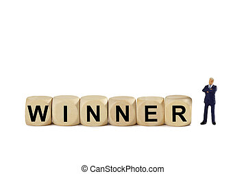 Winner - Figurine with wooden cubes - isolated on white...
