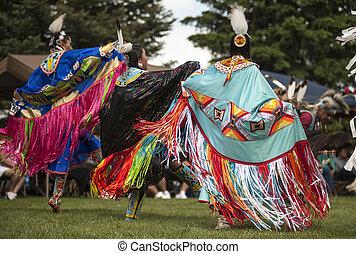 Fancy Shawl Dancers - Three Fancy Shawl dancers compete in...