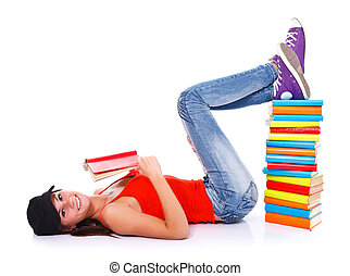 Reading books - Smiling girl lying on the floor holding a...