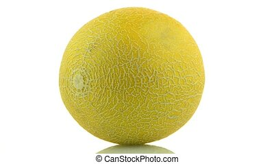 Yellow melon rotating on white background.