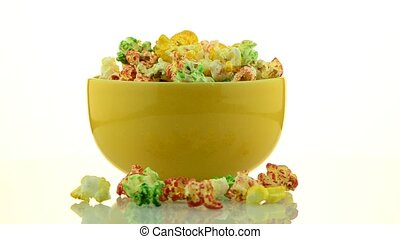 Pop corn - Colorful pop corn on mug rotating on white...