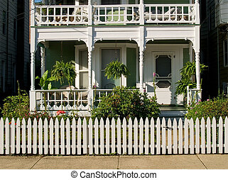 Home Sweet Home - A white picket fence surrounds this...