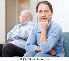 Mature couple after quarrel - Mature couple after quarrel in...