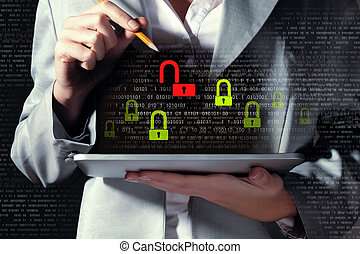 Businesswoman holding tablet pc entering password. Security...