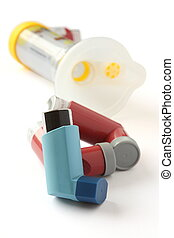 Asthma inhalers with extension tube on a white background -...